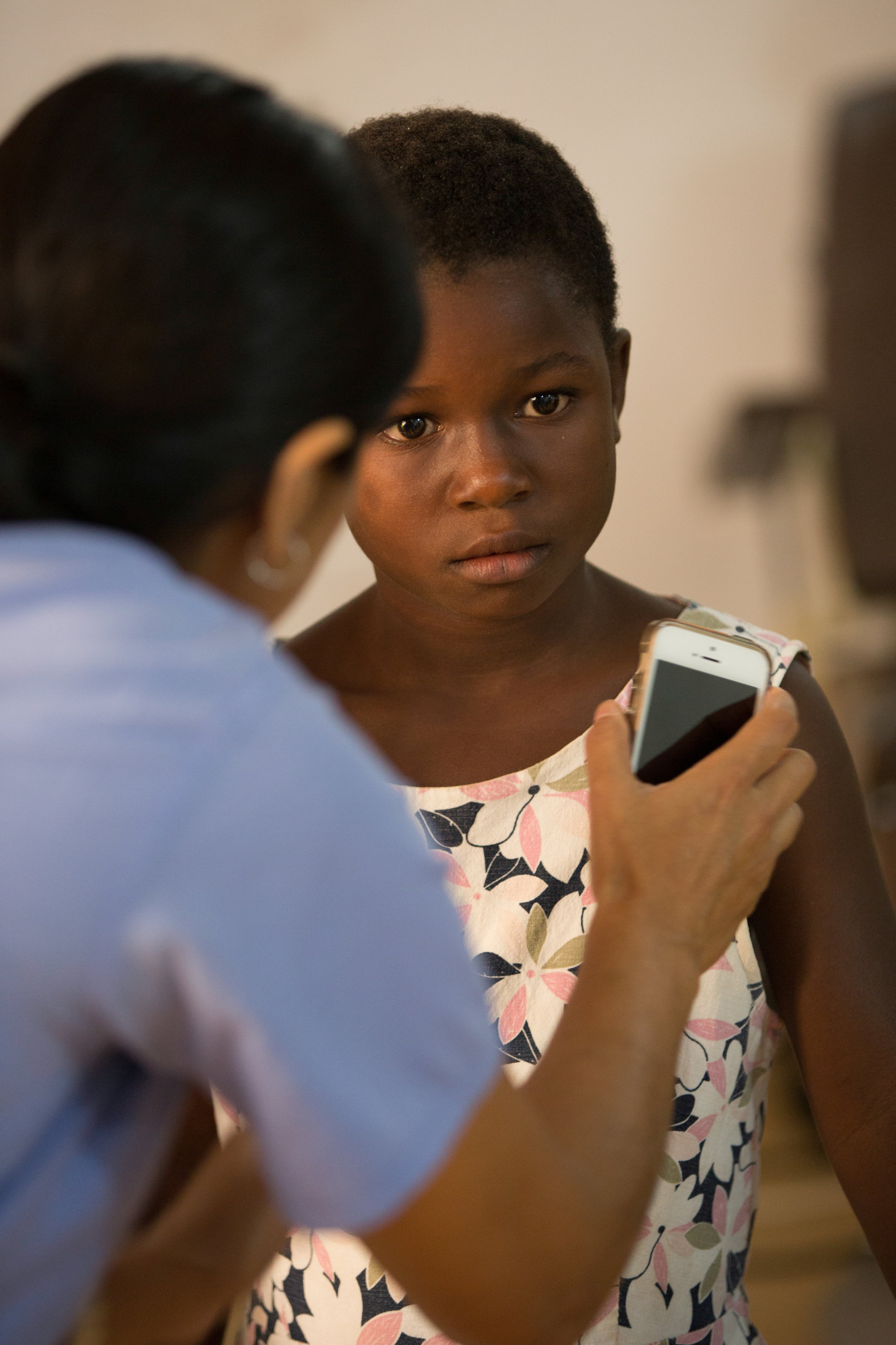 Using a phone light to perform a pupil check.
