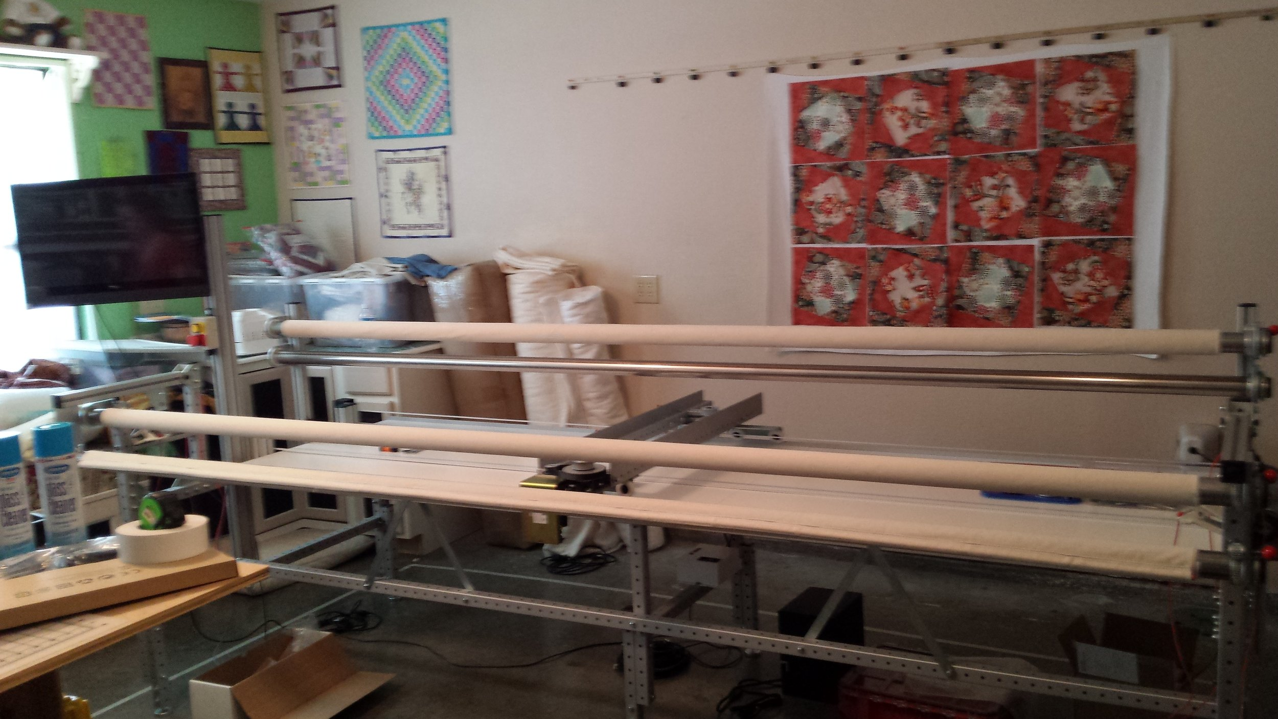 Our Long-arm quilting Machine, and you can see some of our studio.