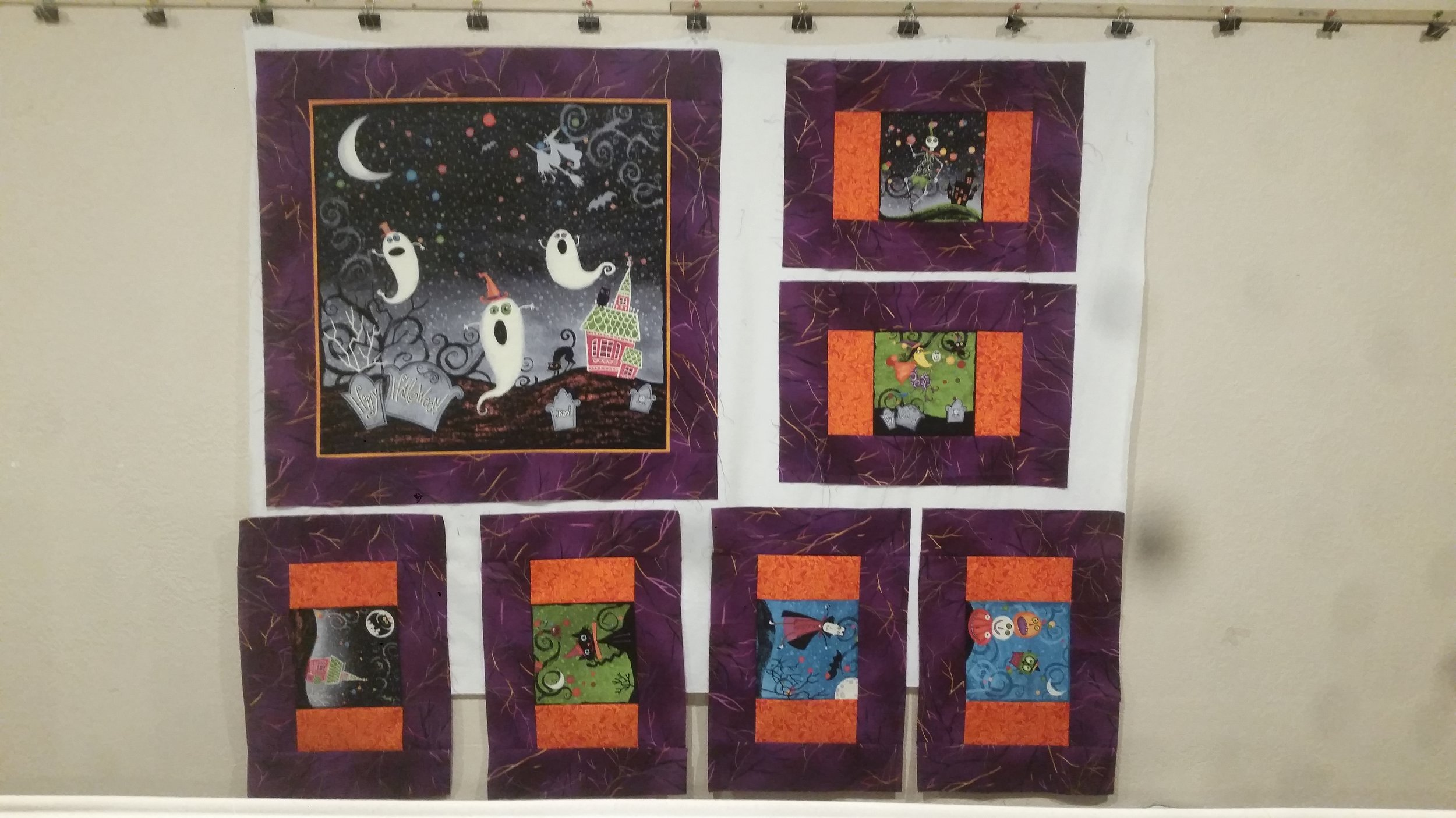 A Halloween wall hanging and place mats.