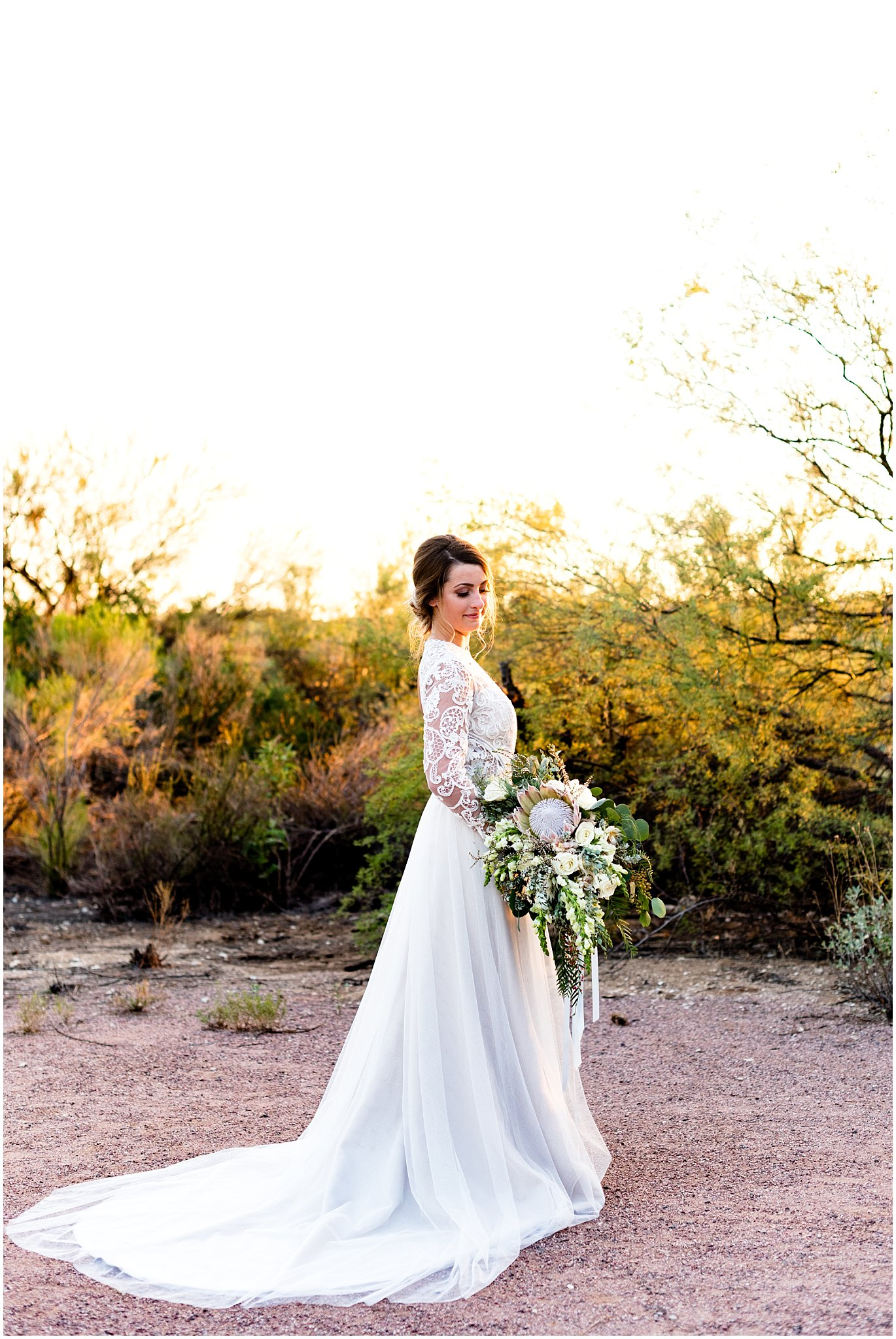 This Ti Adora dress from  J.Bridal Boutique  stole my heart. Long sleeves, lace, an open back, and a small train. What more could you want in a dress?