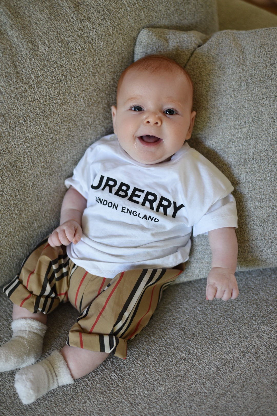 - Julian in a Burberry t-shirt and harem pants.Click on pic to shop!