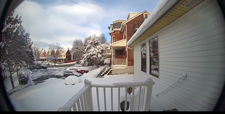A snowy morning from our front door camera!