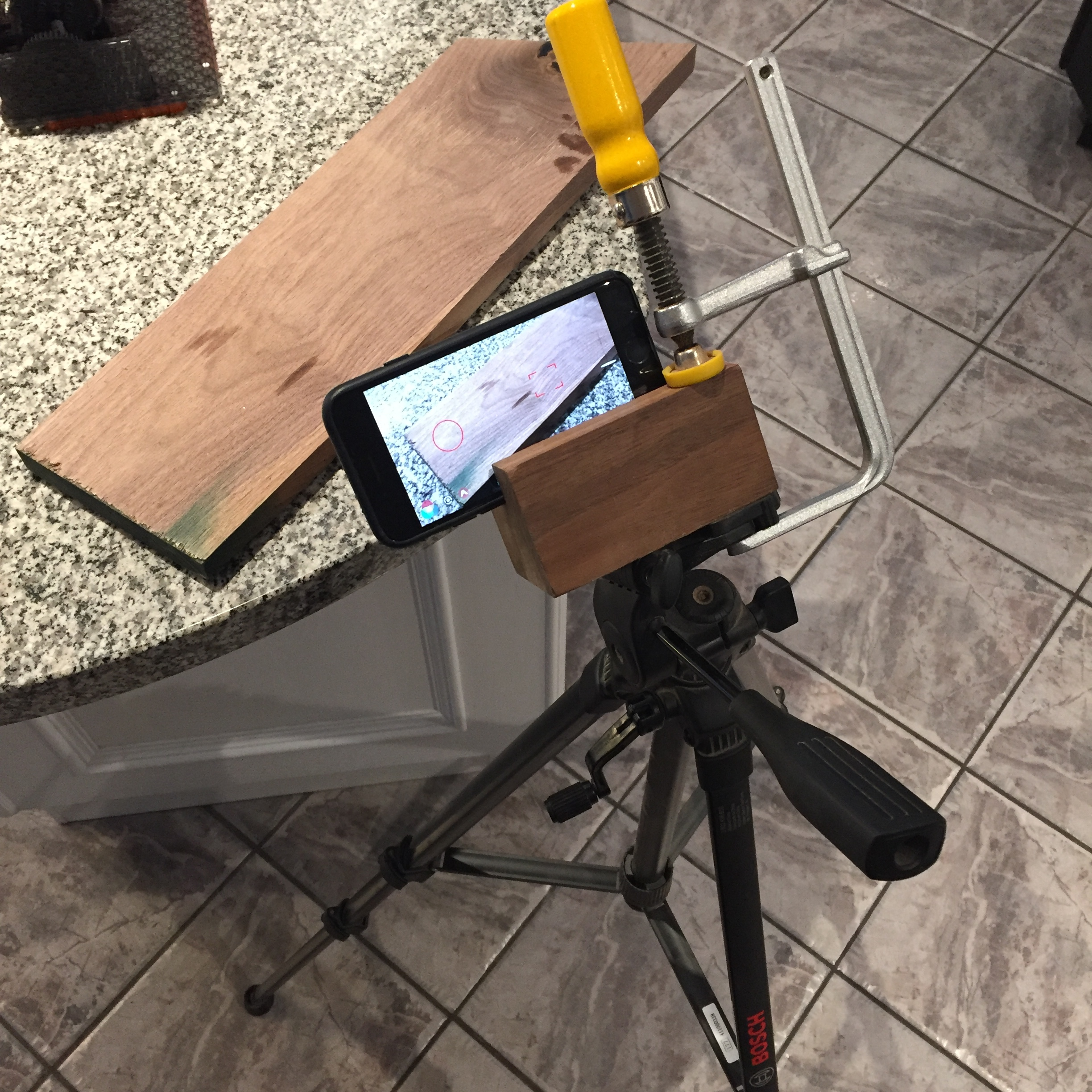 Bosch Tripod with Custom Woodblock iPhone Holder held by MicroJig Dovetail Clamp