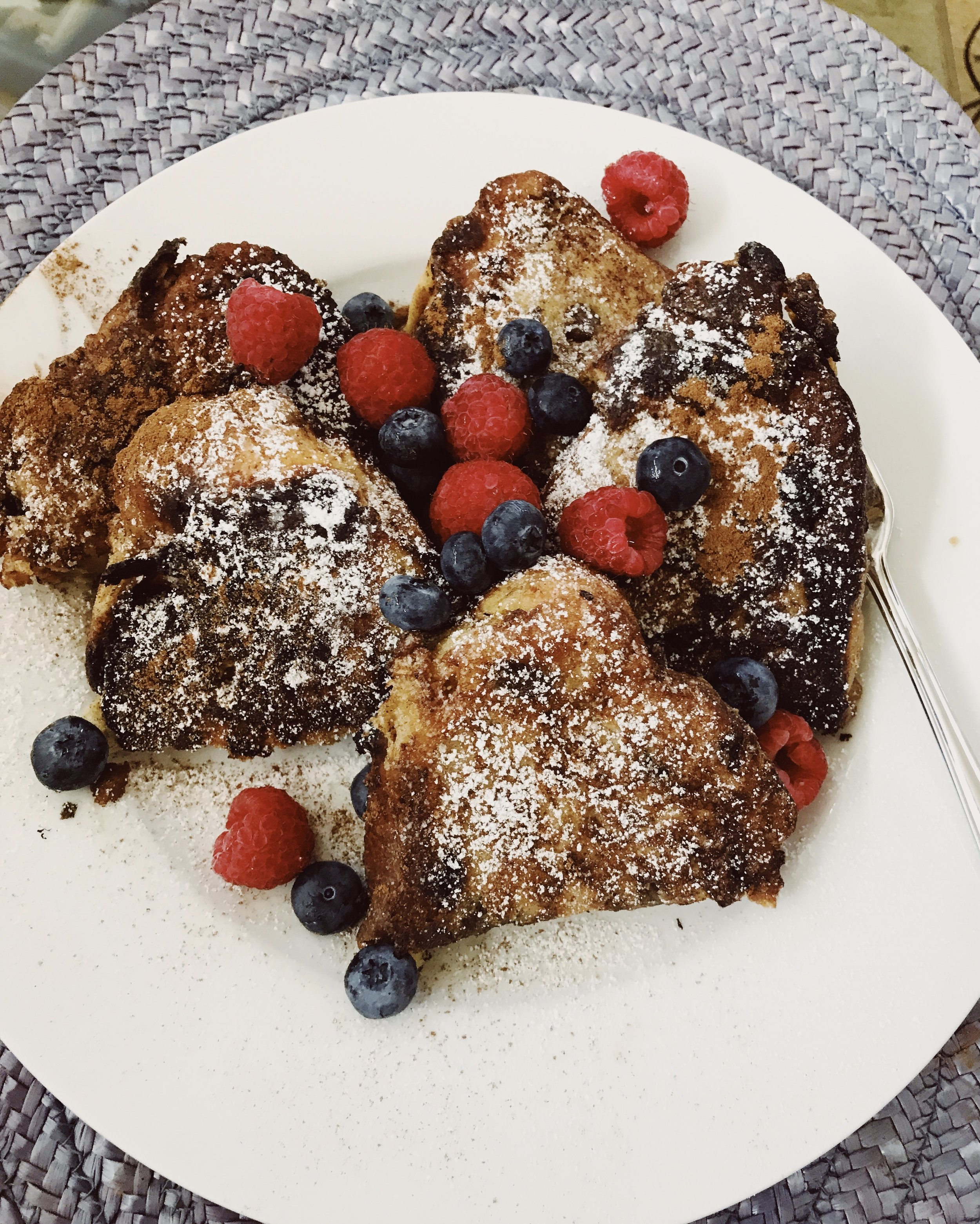 Raisin bread french toast with berries! -