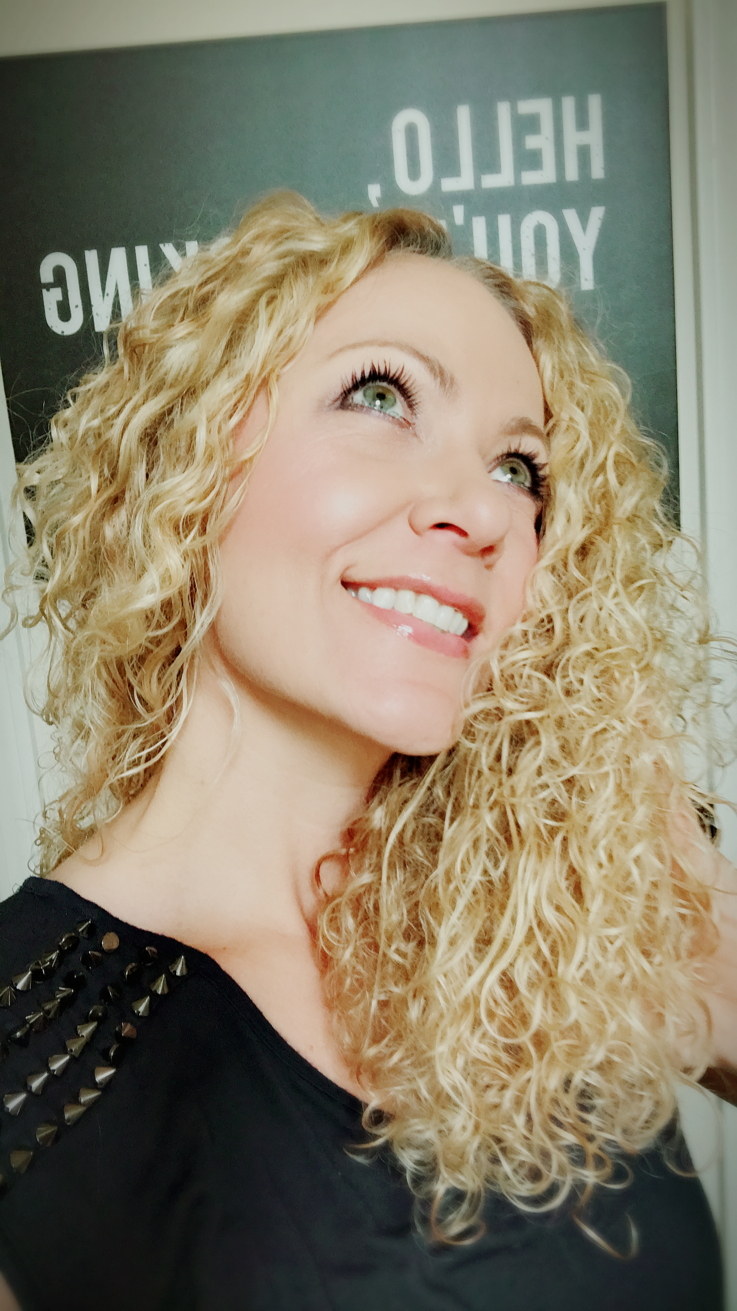 Shiny curls - I get this look with items 1, 2 and 4 below. Conditioning cleanser, leave in oil and leave in conditioner.BOUNCING ON!