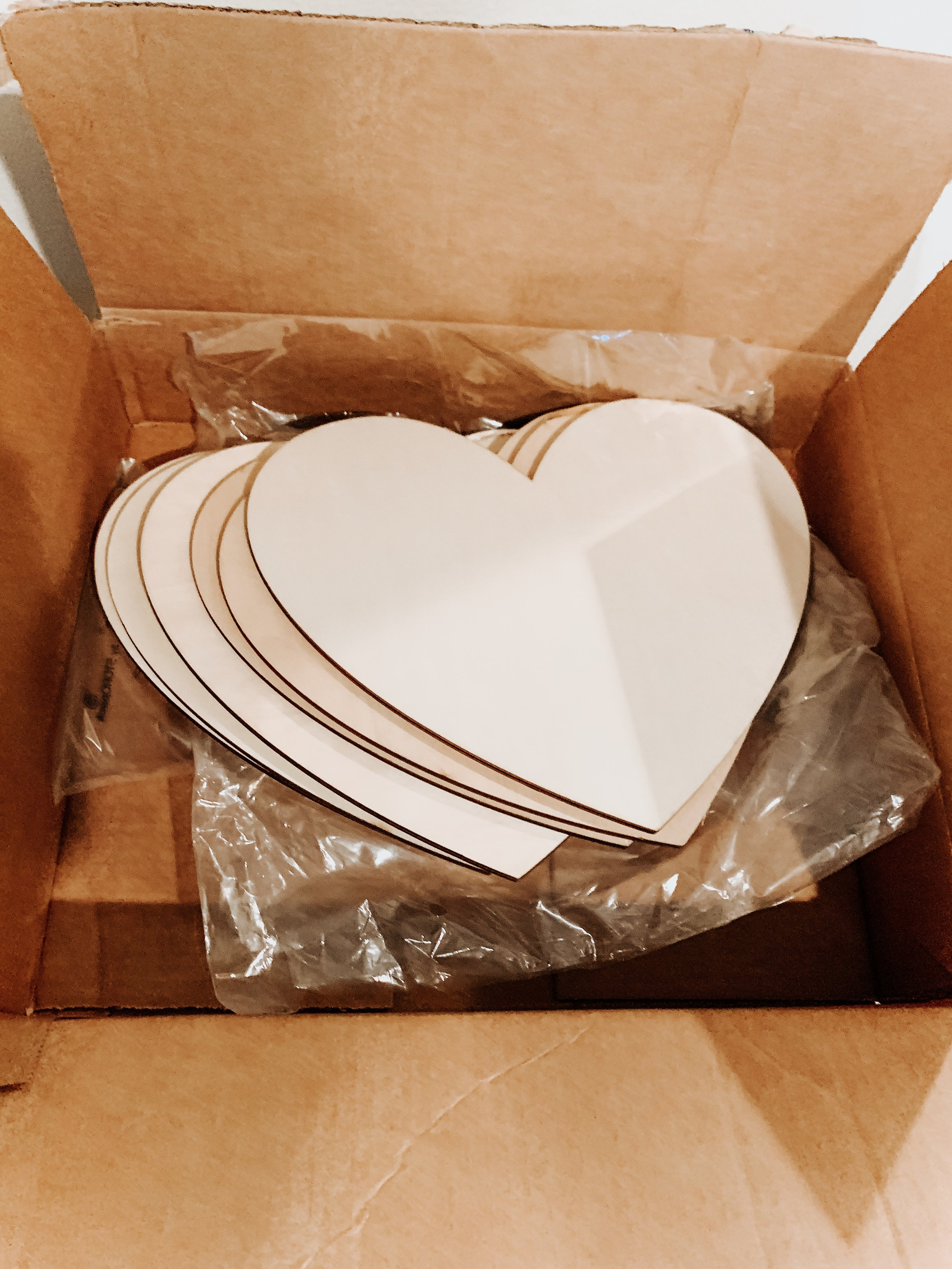 """Wooden Hearts - Pack of 6 unfinished wooden hears approx. 11x8"""" for $14.95 from Amazon"""