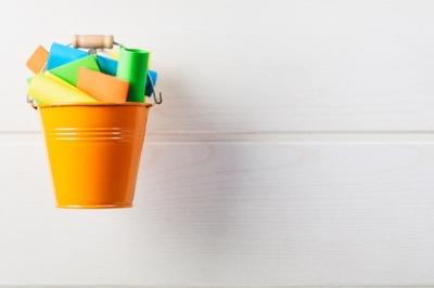 orange bucket colorful papers.jpg