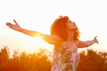 Black woman outstretched arms in sunlight.jpg