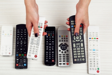 woman's hands with remote controls.jpg