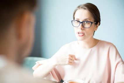 woman in glasses having serious conversation.jpg