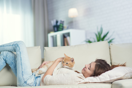 woman lying on sofa with cat.jpg