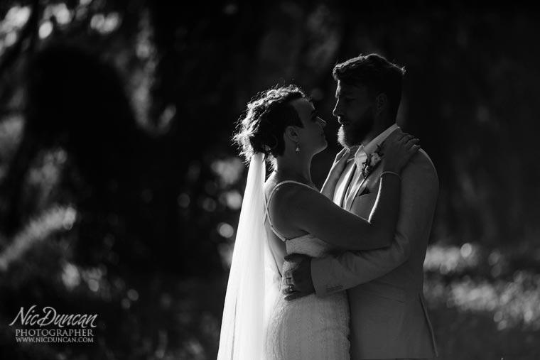 bride & groom backlit
