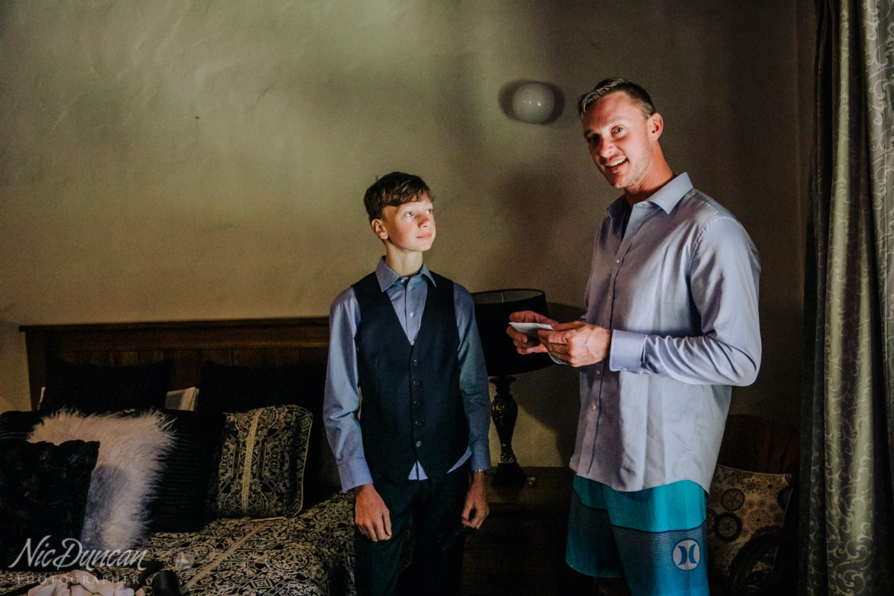 Groom and son getting ready together