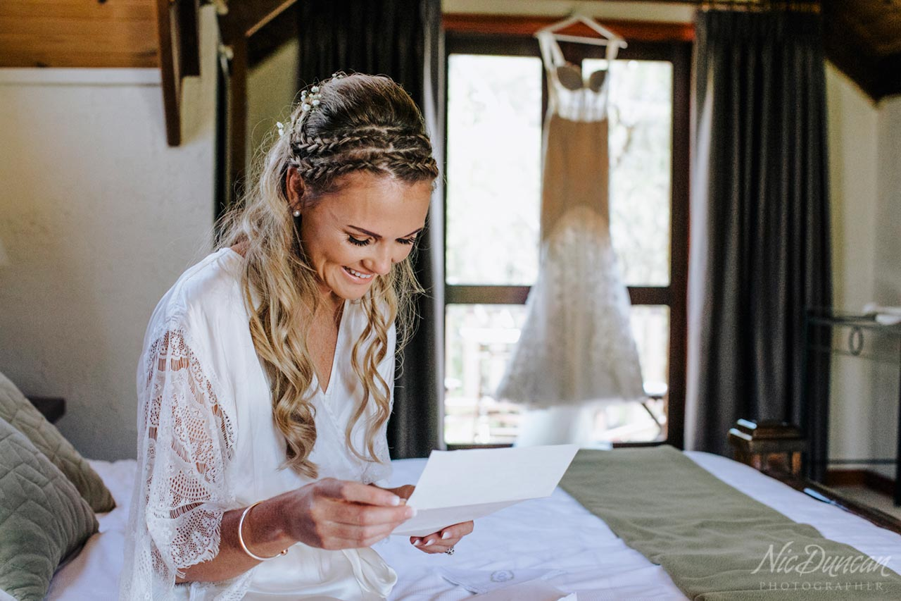Bride reading a letter from the groom