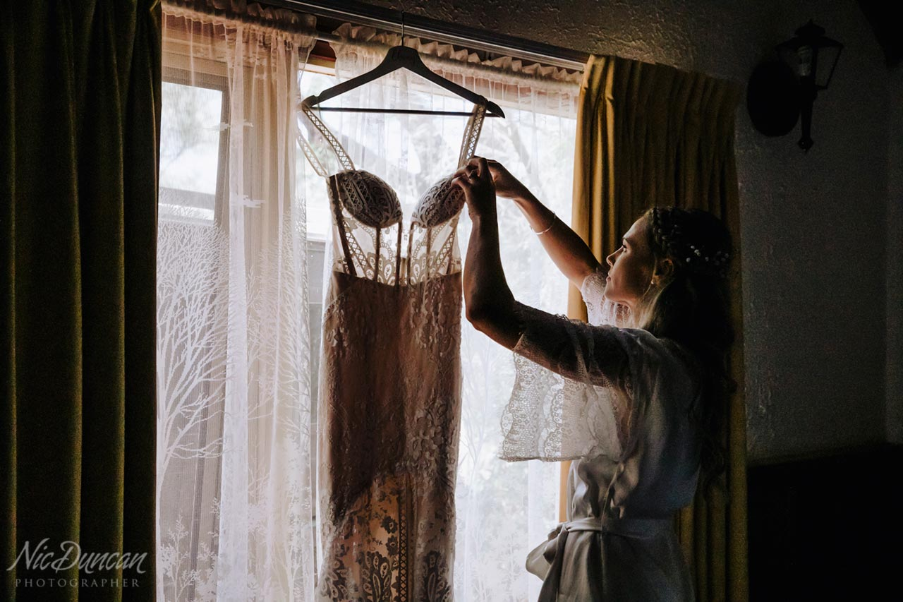 Wedding dress hanging in the window at William Bay Country Cottages, Denmark