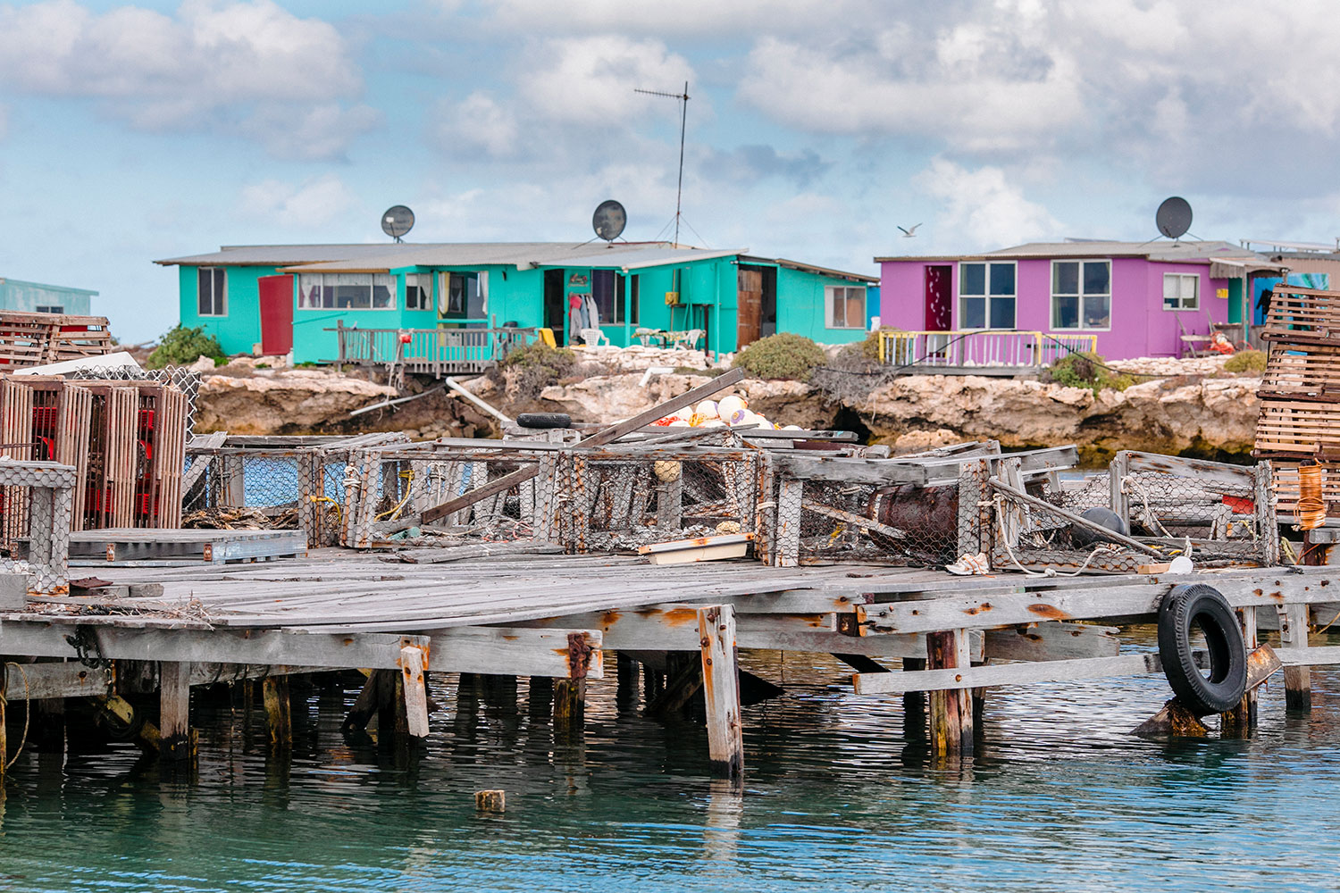 Fishing shacks, craypots and old jetty at the Abrolhos Islands Western Australia