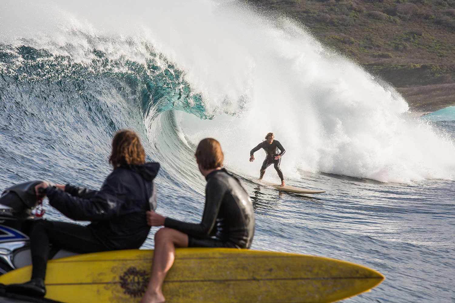 Behind the scenes surf shot Sando (Simon Baker) with Samson Coulter watching on from the jet ski