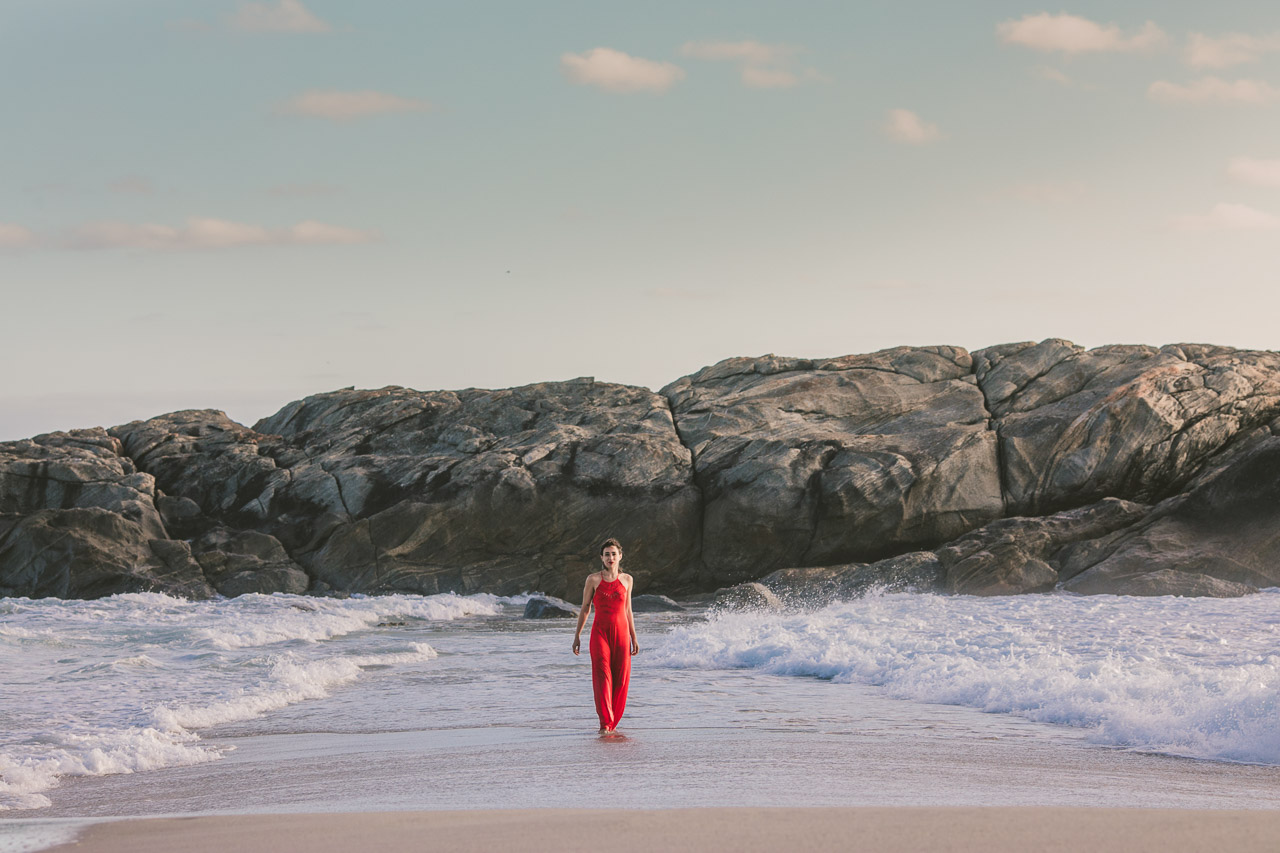 Parting the water, red dress, waves and ocean portrait