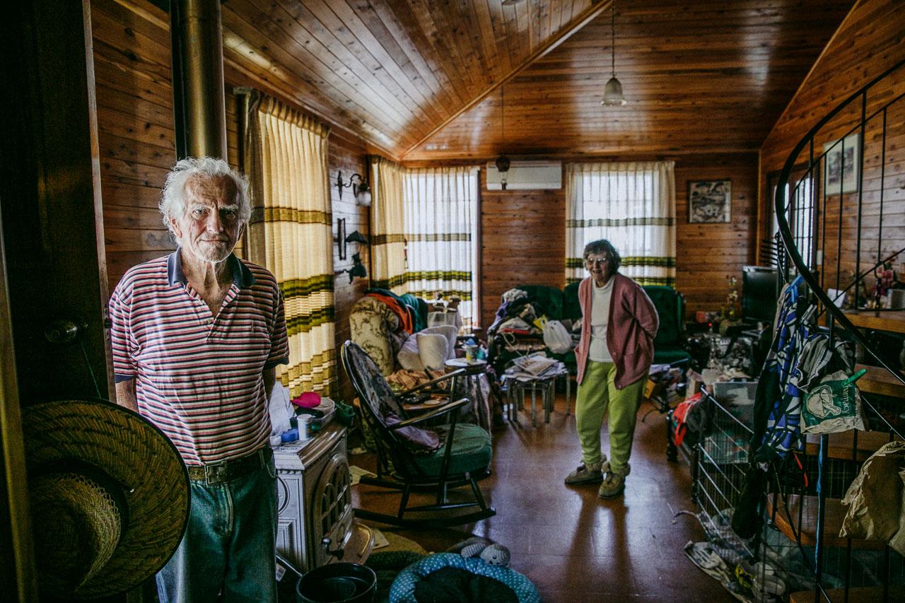 Elderly couple in their living room