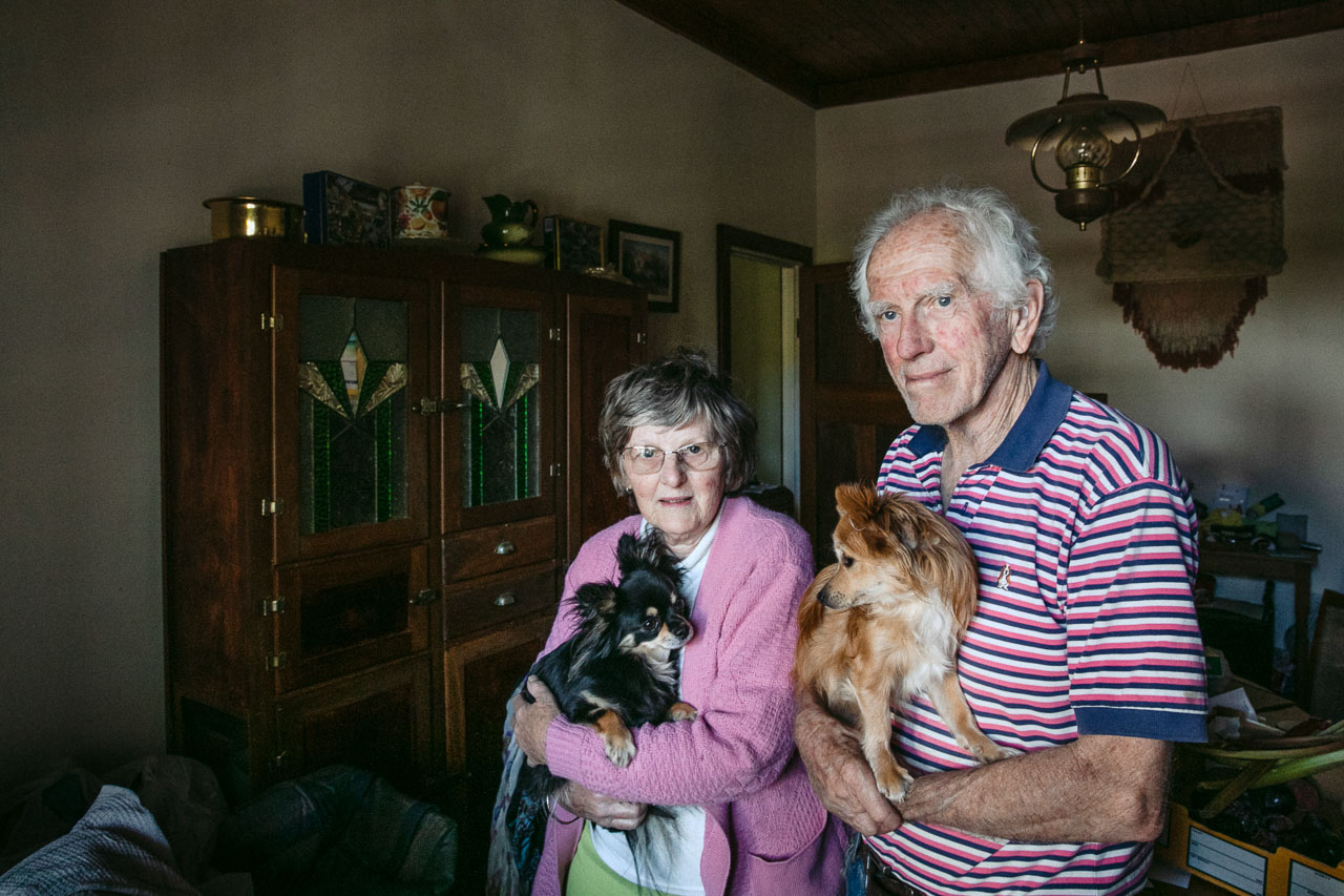 Beautiful older couple with their pet dogs