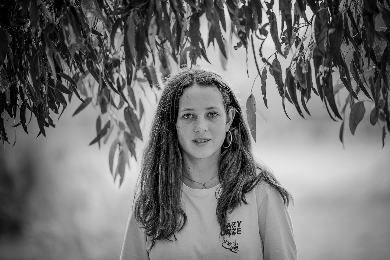 Portrait of a teenage girl and eucalyptus leaves