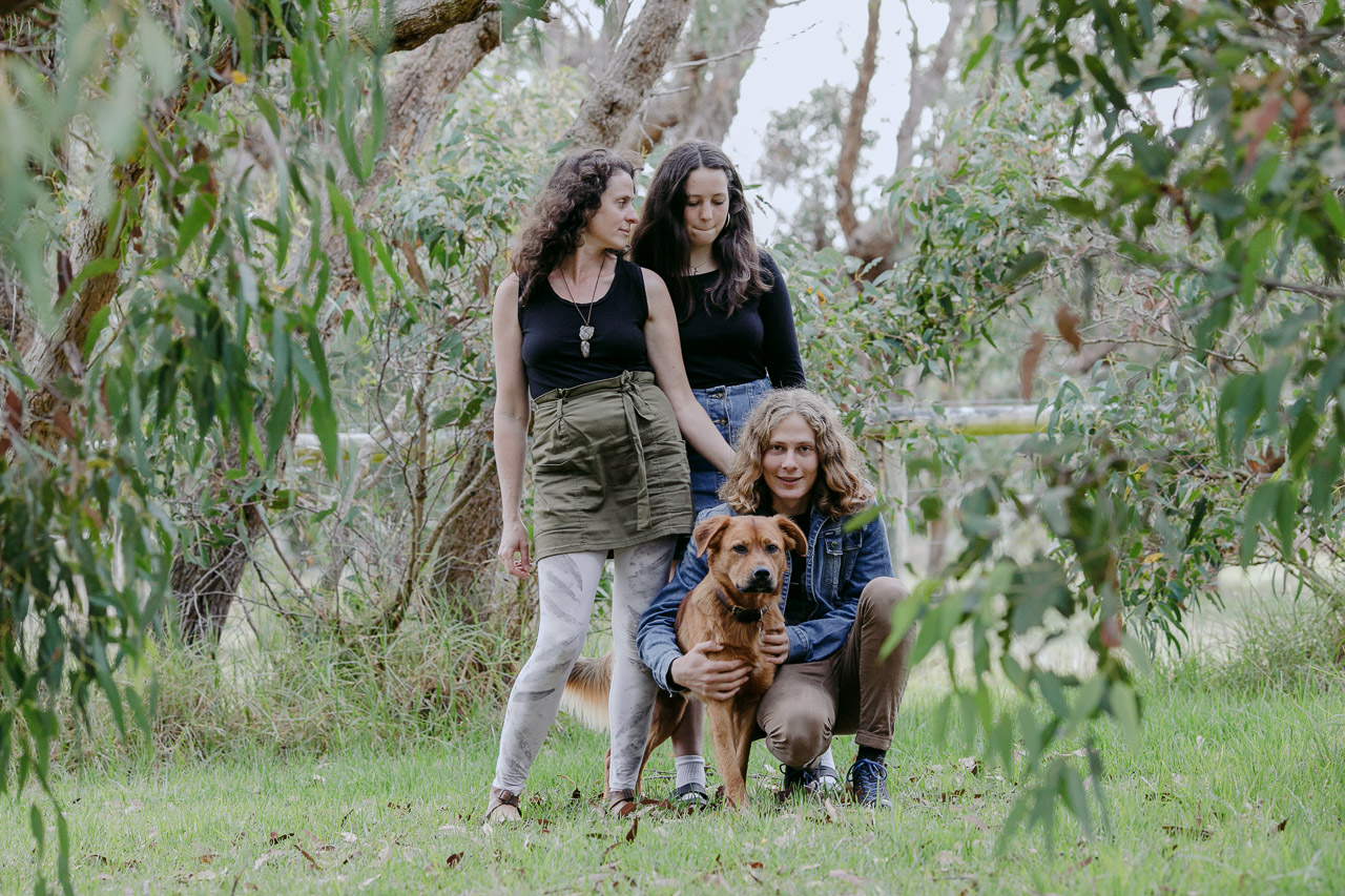 Family portrait in the garden, Mum, teenage son and daughter, and their pet dog