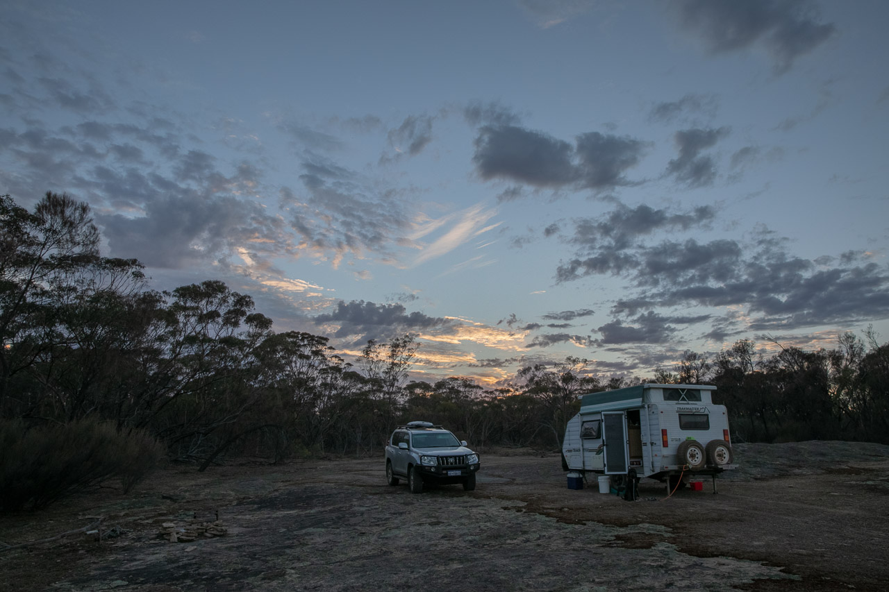 Camping as the sun rises over the granite outcrop in Lake Grace, Western Australia