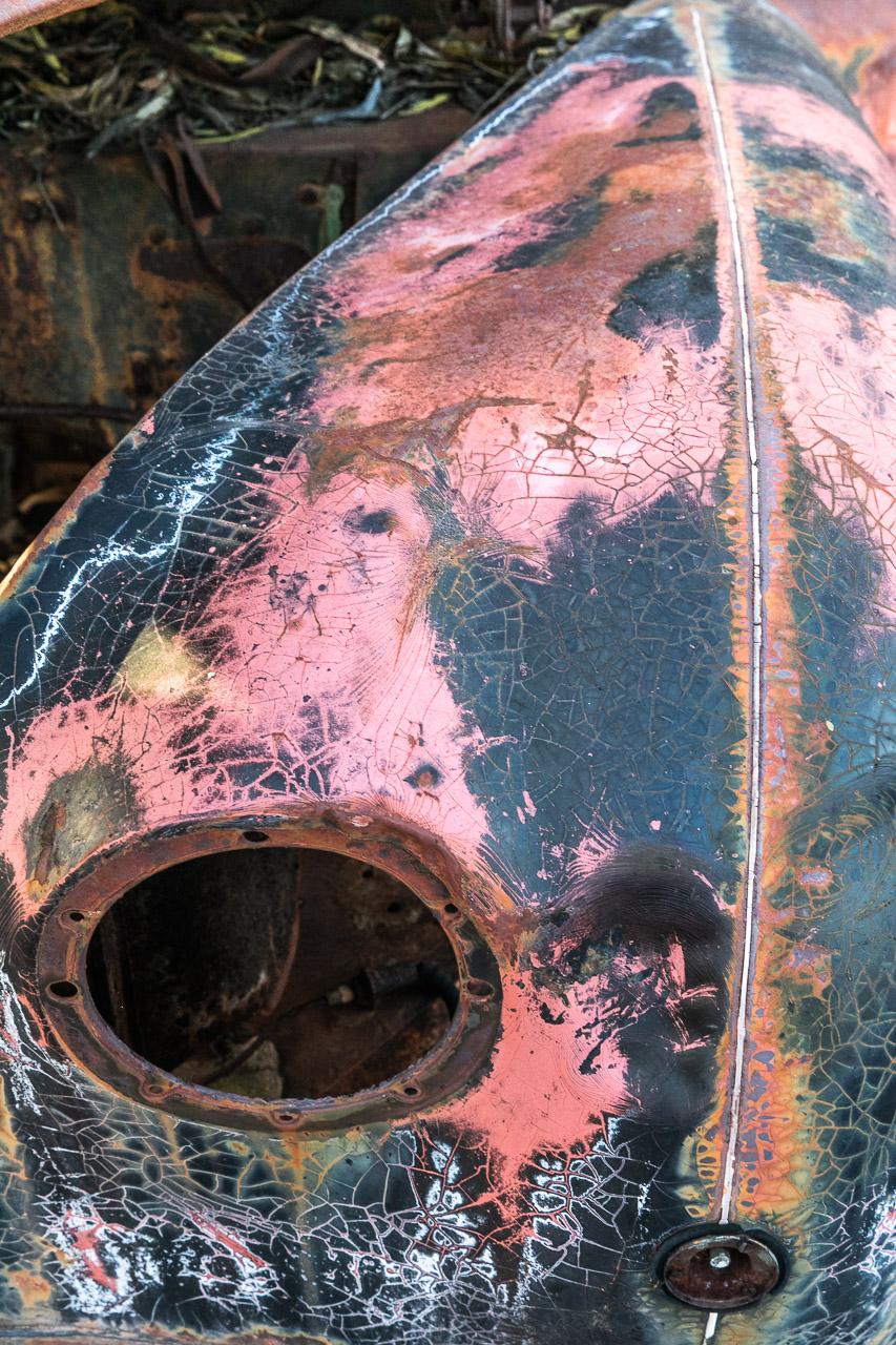 Textures and patterns in the rusted paintwork of an old Austin car