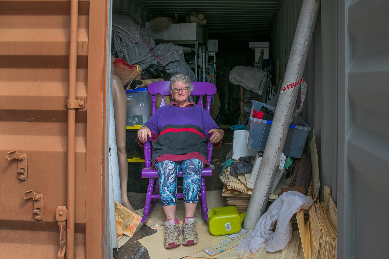 Artist Kerrie Argent in one of her many sea containers housing her artwork