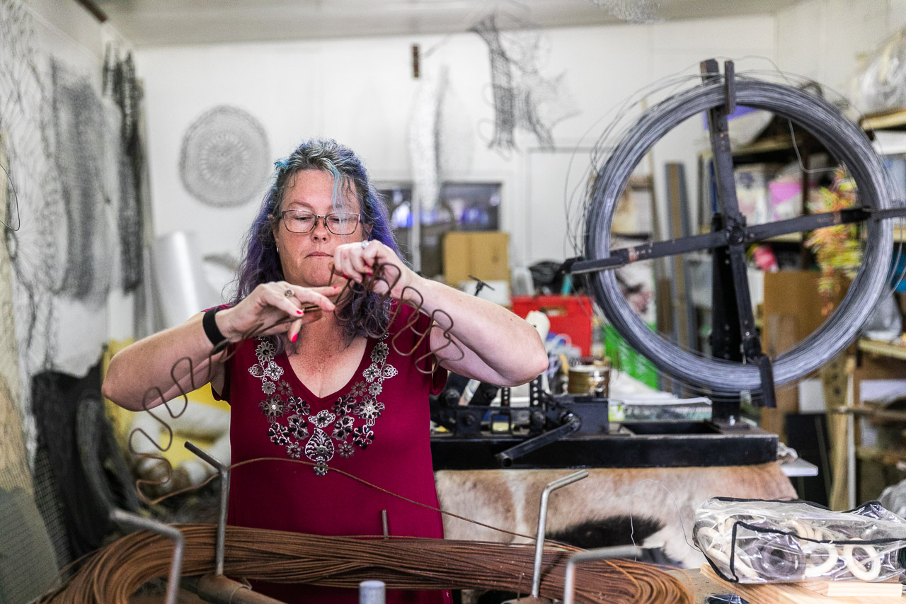 Artist Tania Spencer knitting with wire