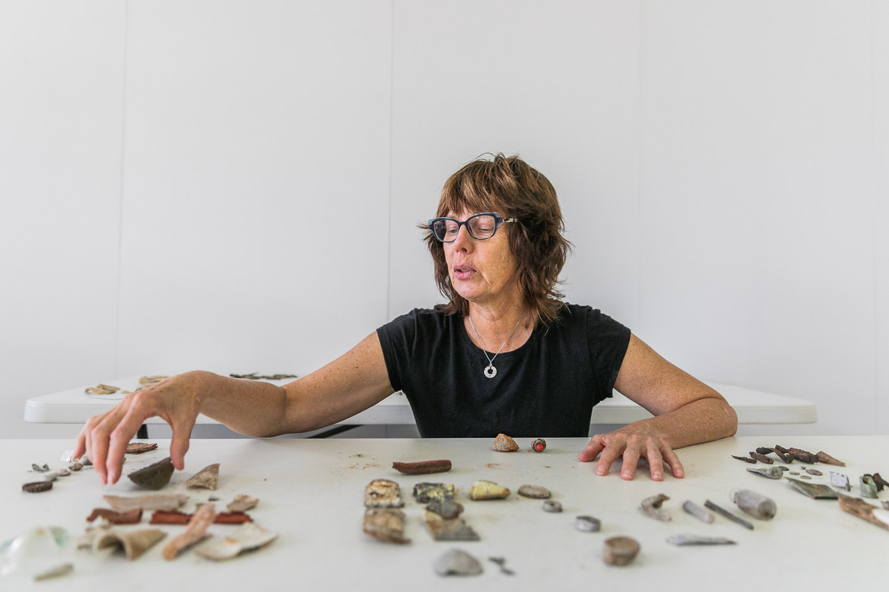 Michelle Slarke with some of the found treasures from the old hospital making up her artwork