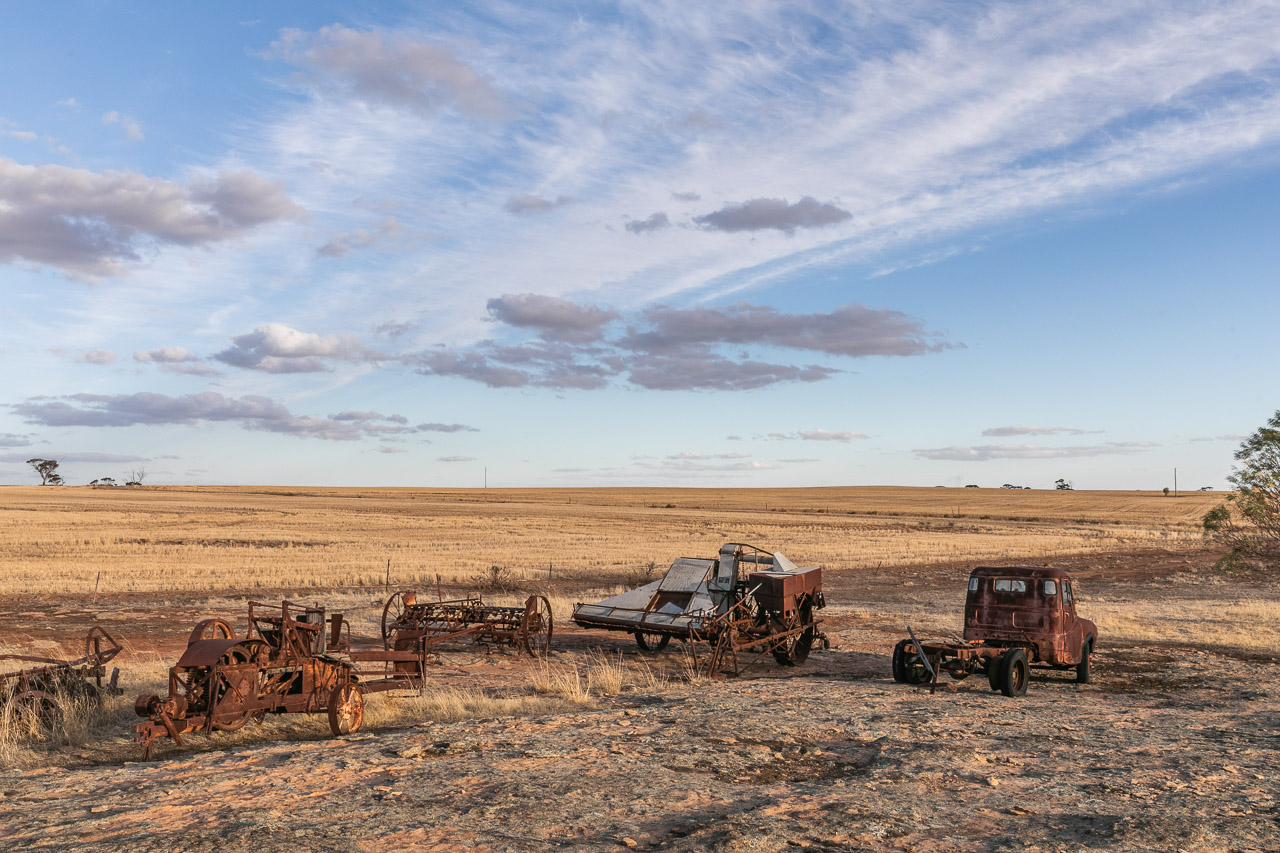 Old farm vehicles, dry paddock and interesting sky in the Wheatbelt