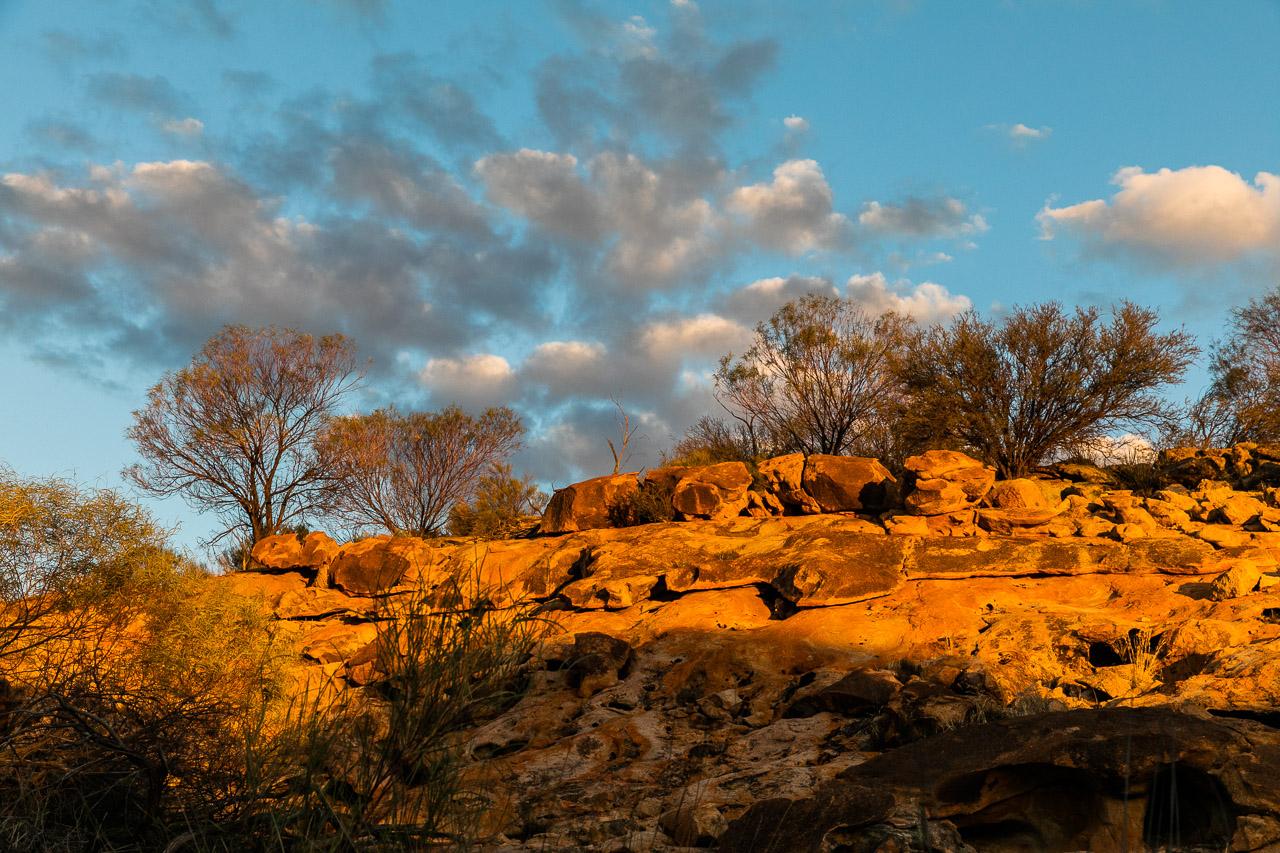The setting sun lights up the landscape at Eaglestone Rock near Mukinbudin in WA