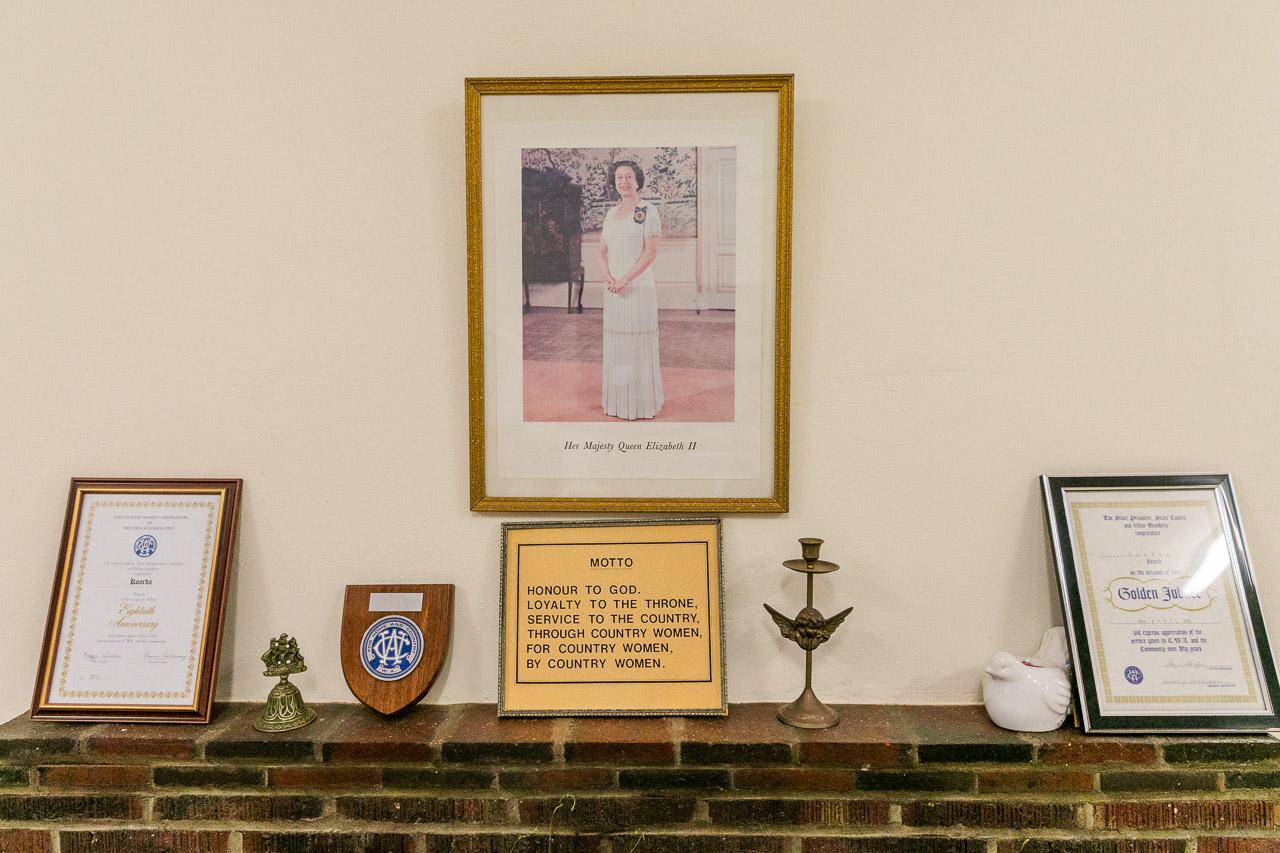 The framed photo of the Queen in the CWA hall