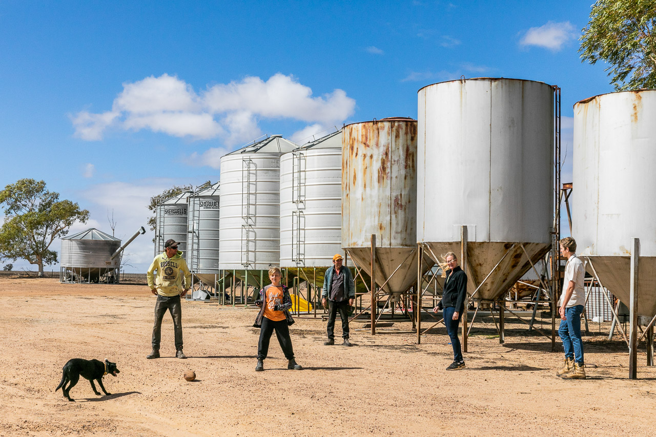 Family photo session on the farm with silos