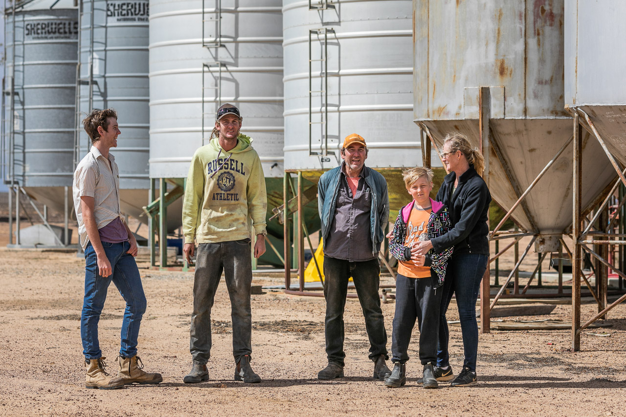 Portrait session by the silos on the family farm