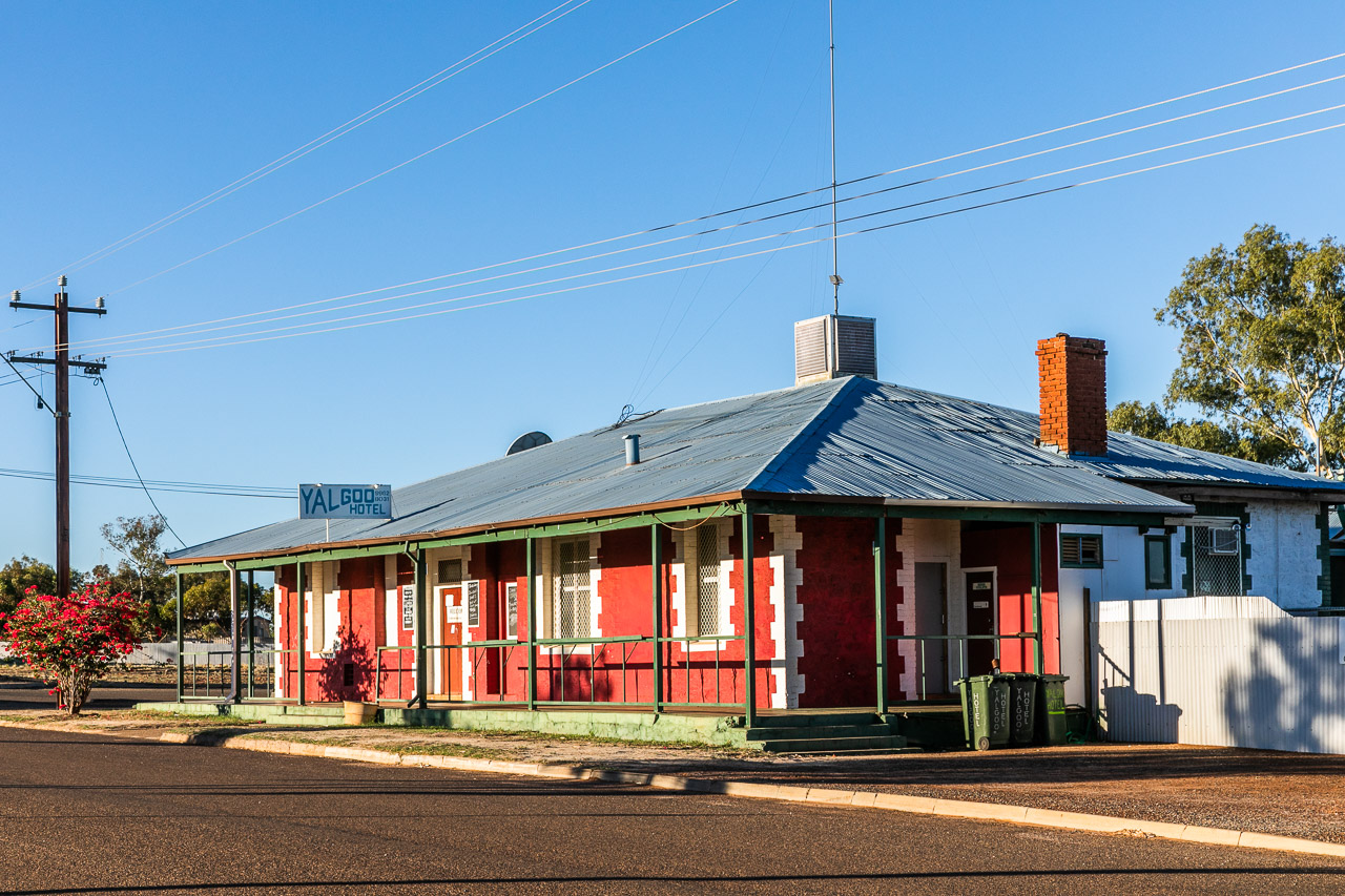 The Yalgoo Hotel glowing hot pink in the late afternoon sun