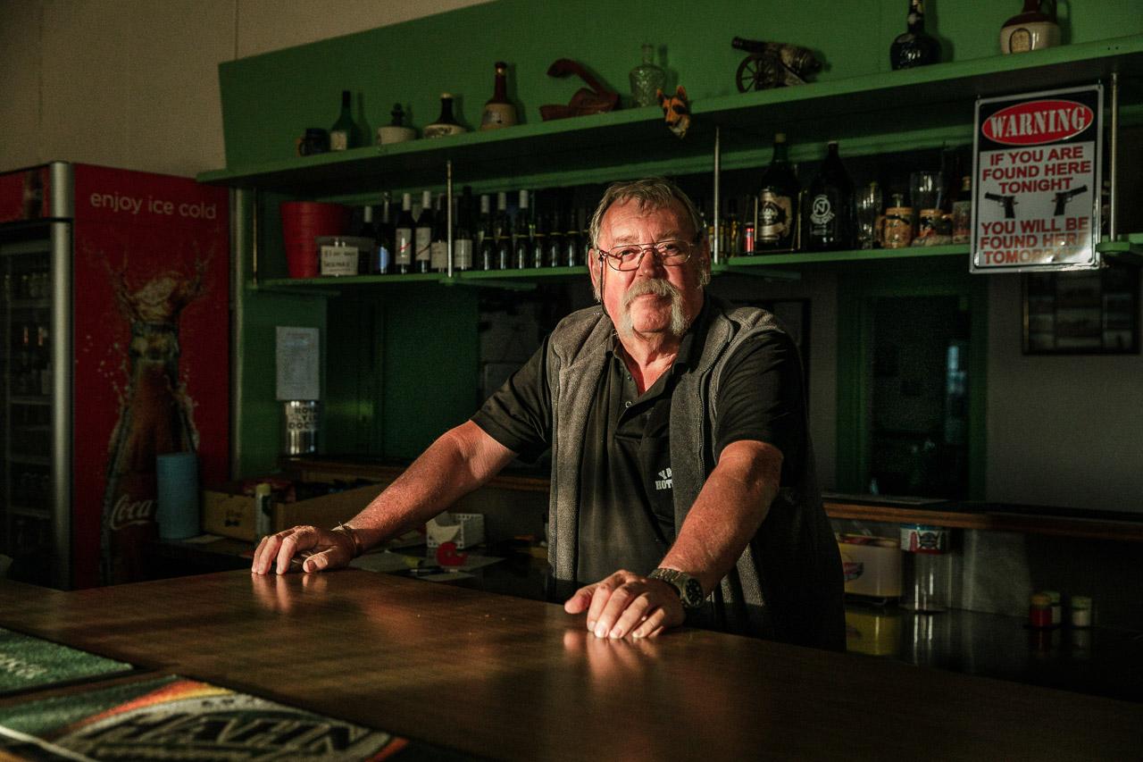 Publican behind the bar in the remote Yalgoo Hotel in Western Australia