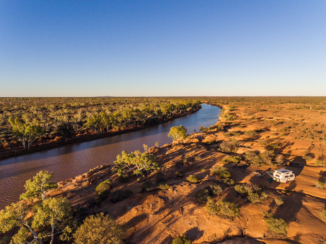 The Murchison River flowing and brown after the recent rains and the run-off