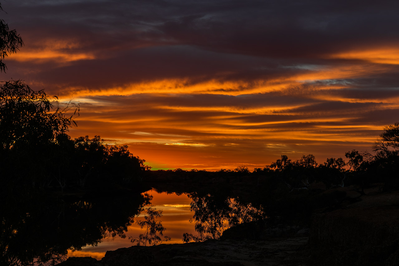 The sunrise reflecting perfectly in the Murchison River at Wooleen
