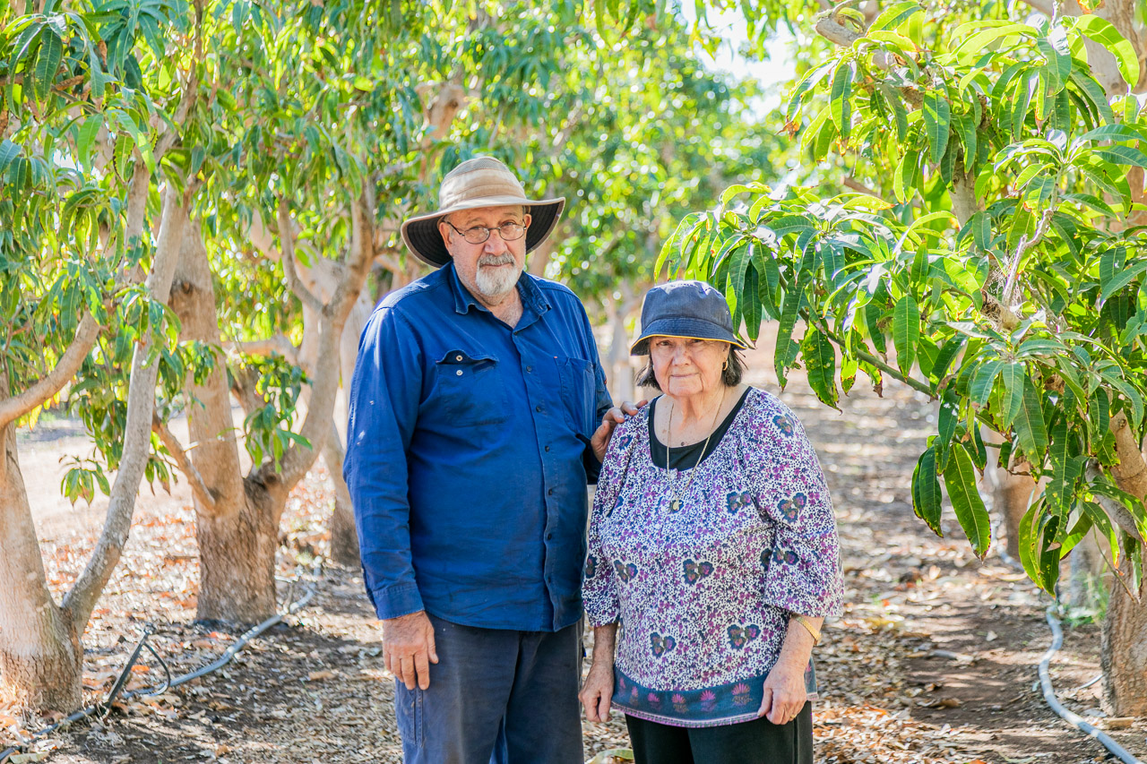 Growers Rick and his mother Zarka in a row of mango trees at their Carnarvon property