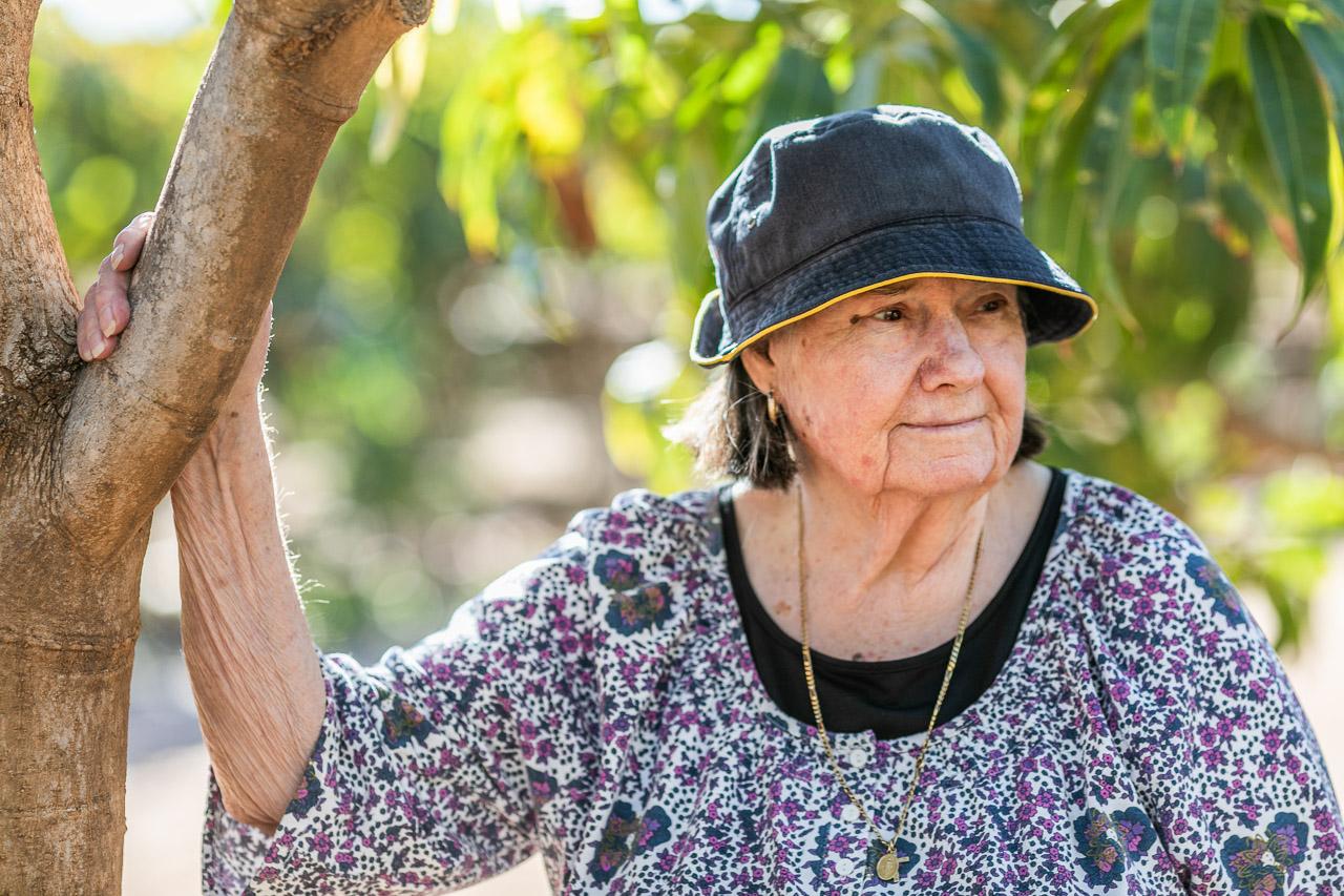 Retired grower in Carnarvon beside a mango tree