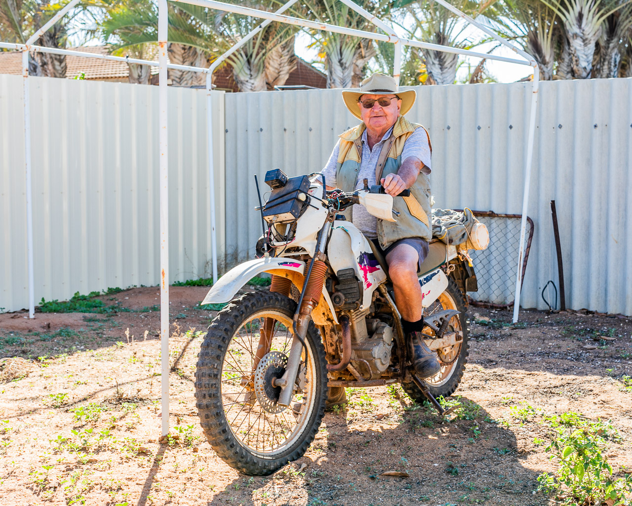 Old roo shooter on a motorbike