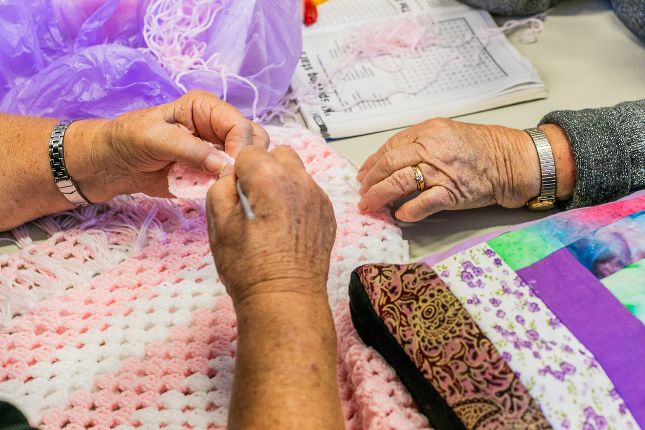 Old ladies' hands and crocheting