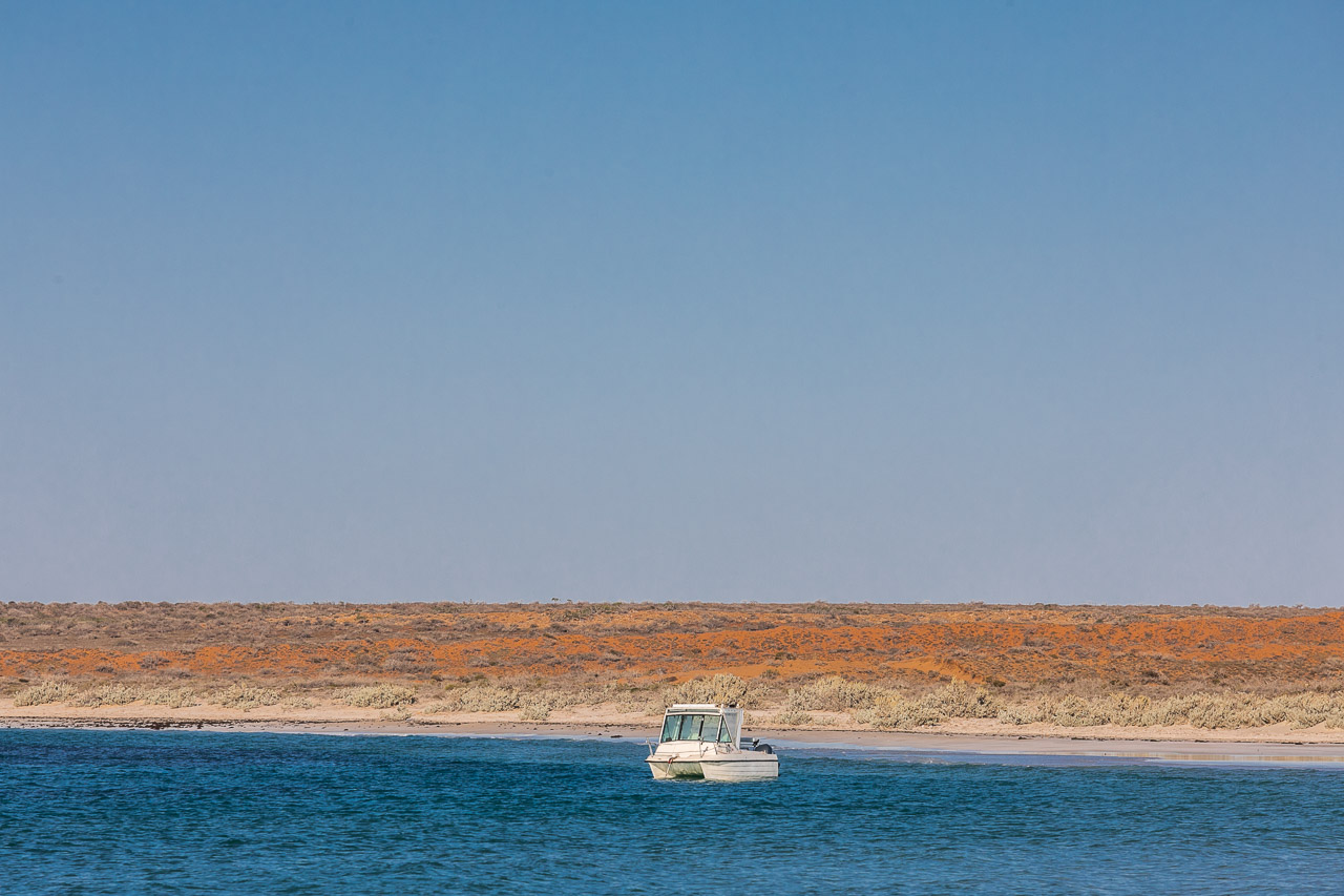 A boat in the calm waters of Gnaraloo Bay