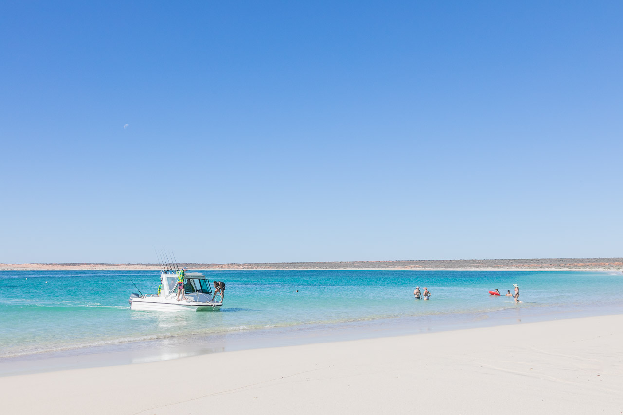 Boats and people in Gnaraloo Bay