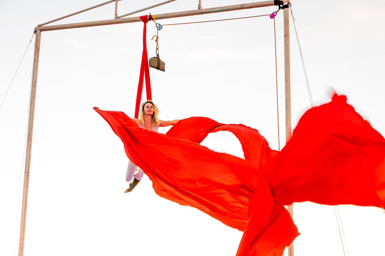 Red silks flying in the breeze - Jade Mills rehearses for her aerial performance