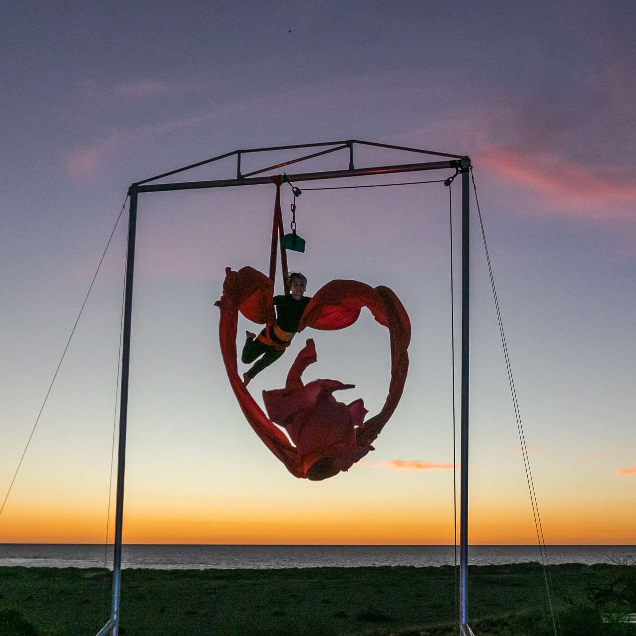Aerial artist Theaker von Ziarno rehearsing at sunset