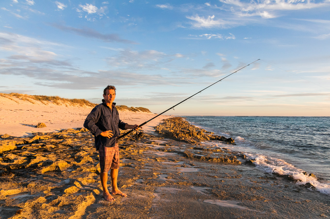 Beach fishing in Western Australia at sunset