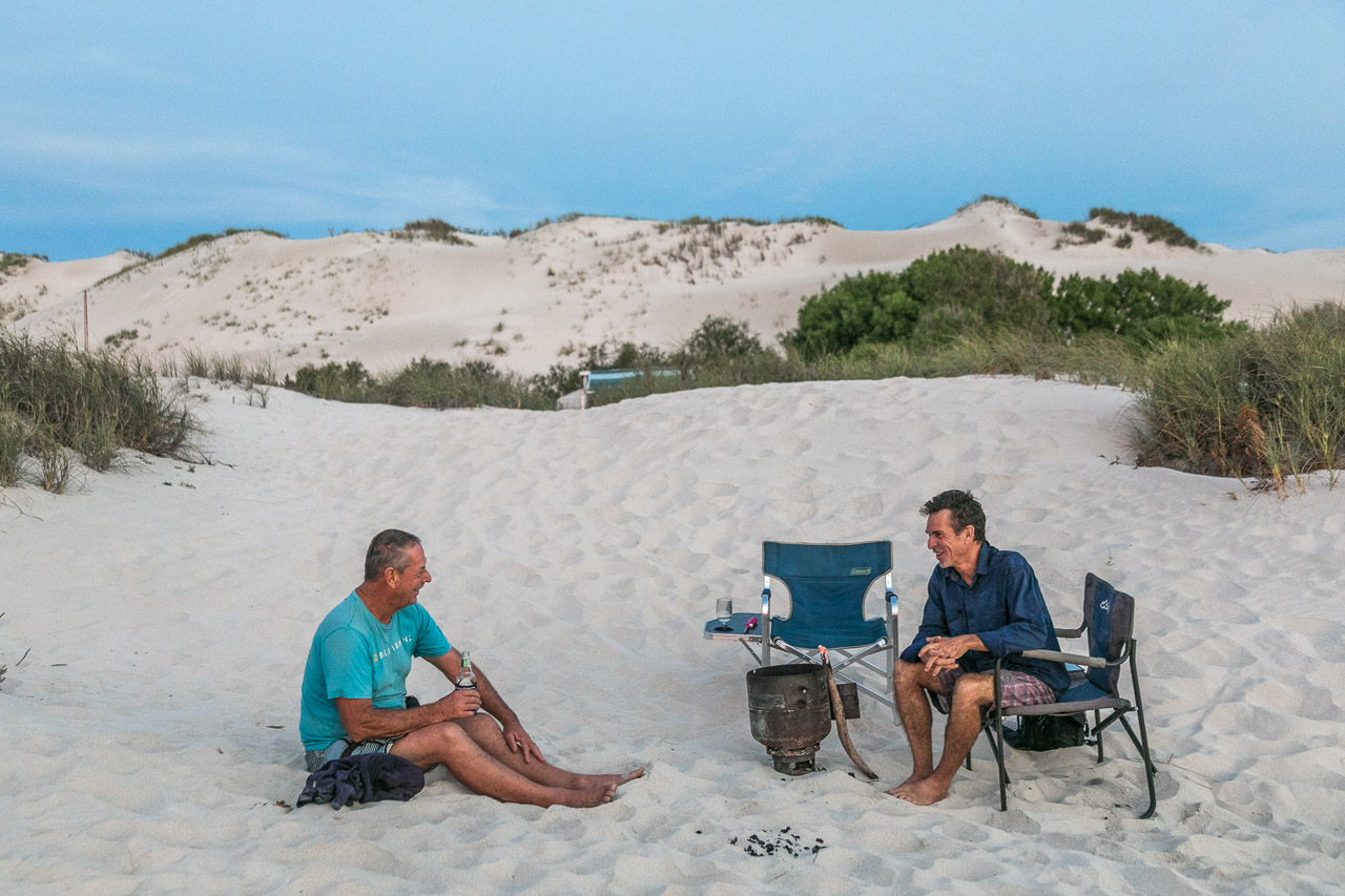 A beer and a chat around the camp fire